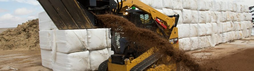 CAT side discharge buckets provide controlled flow of loose materials in varied applications